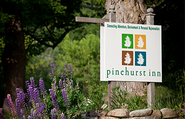 a photograph of the Pinehurst Inn sign in the front yard