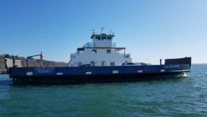 ferry boat on lake superior on dark blue water and bright blue sky
