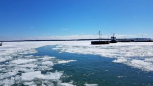 ice formations on blue waters of lake superior with blue skies with white clouds