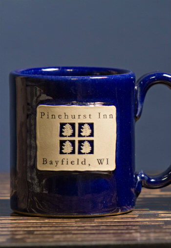 Cobalt blue coffee mug that says Pinehurst Inn, Bayfield, WI